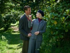 Armie Hammer as Maxim de Winter and Lily James as Mrs de Winter (Kerry Brown/Netflix/PA)