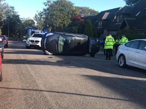 Police called after car overturns onto roof following crash in Aberdeen