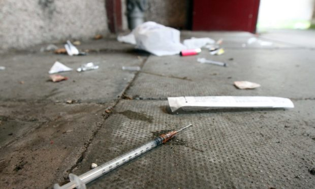Courier/Tele News. James Simpson story. A Dundee man returned home today to find his common close (off Albert Street) littered with discarded needles and other drug paraphernalia. Pic shows; needles and other drug related items found in the close which had it's door kicked in. Friday, 8th September, 2017.