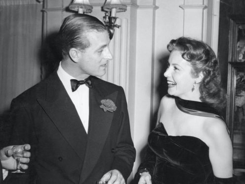 Actress Rhonda Fleming, star of Hollywood's Golden Age and pictured here with the Duke of Edinburgh, has died at the age of 97, her secretary has said (PA)