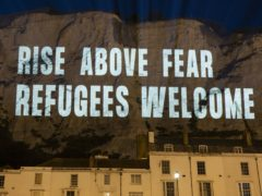Handout photo supplied by Freedom from Torture/POW showing the White Cliffs of Dover being lit up with a series of massive projections in support of migrant welfare on Friday evening (Freedom from Torture/POW/PA)