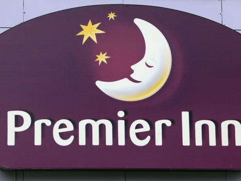 Premier Inn owner Whitbread swung to a half-year loss as the UK hotel market was hit by local restrictions and instructions for workers to stay at home (Lewis Whyld/PA)