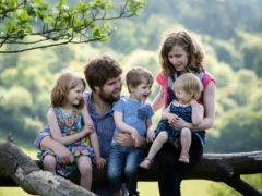 Zoe Powell with her husband Josh and children (Sarah Mak Photography/PA)