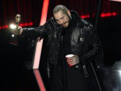 Post Malone was the big winner at the delayed Billboard Music Awards, taking home nine gongs including top artist (AP Photo/Chris Pizzello)