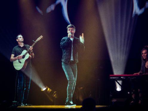Singer songwriter Dan Olsen performs as an interactive hologram (Aaron Chown/PA)