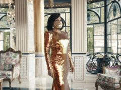Dame Shirley Bassey, 83, wearing a matching face mask and sequined gold gown during a photo shoot in Italy for her forthcoming album Owe It All To You (Universal Music Group/PA)