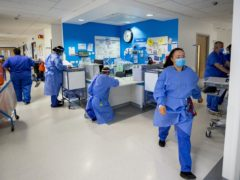 Hospital staff on one of five Covid-19 wards at Whiston Hospital in Merseyside (Peter Byrne/PA)