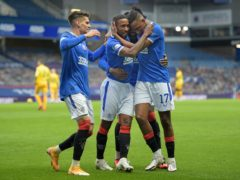 Jermain Defoe, centre, celebrates scoring his side's second goal (Jane Barlow/PA)
