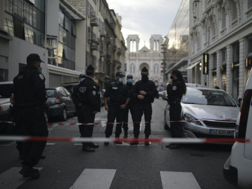 Police patrol on a street outside the Notre Dame church in Nice (Daniel Cole/AP)