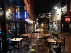 An empty seating area outside a bar in Nottingham after pubs and bars closed (Joe Giddens/PA)