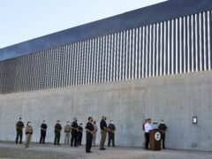 Acting Homeland Secretary Chad Wolf gives a speech in front of a new section of the border wall on Thursday (Joel Martinez/The Monitor/AP)