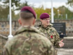 Reverend Ollie North briefs members of 13 Air Assault Regiment RLC about the locations of the remembrance trail (Cpl Danny Houghton)