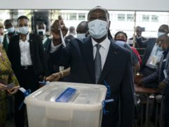 Ivory Coast president Alassane Ouattara casts his vote at a polling station during presidential elections in Abidjan, Ivory Coast (Leo Correa/AP)