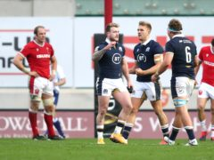 Stuart Hogg (centre) and Jamie Richie celebrate as Scotland ruined Wales captain Alun Wyn Jones' (left) landmark day as rugby union's most capped player (David Davies/PA)