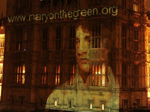 An image of Mary Wollstonecraft is projected on to the Houses of Parliament (Georgie Gillard/PA)