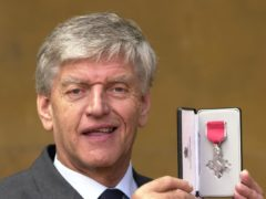 Actor Dave Prowse, alias Star Wars' villain Darth Vader, after receiving a MBE for services to charity and road safety for playing the Green Cross Code man (John Stillwell/PA)