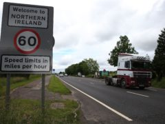 Traffic crosses the border between the Republic of Ireland and Northern Ireland in the village of Bridgend, Co Donegal (Brian Lawless/PA)