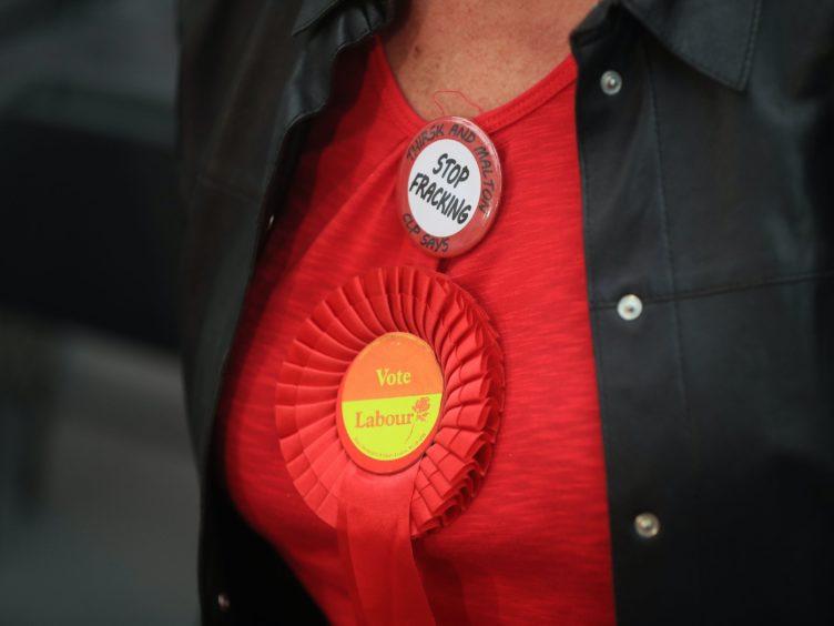 A Labour Party rosette (Danny Lawson/PA)