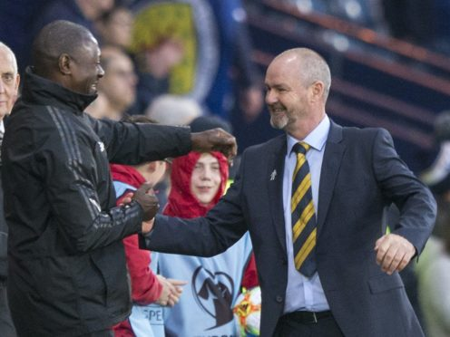 Alex Dyer (left) wants his players to aim for a place in Steve Clarke's Scotland squad next summer (Jeff Holmes/PA)