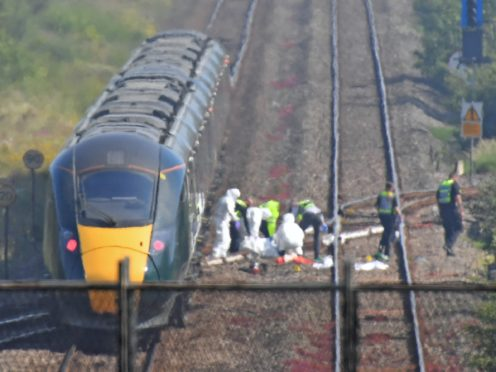 Network Rail's long-term failure to improve safety was an underlying factor in the deaths of two track workers in South Wales, an investigation has found (Jacob King/PA)