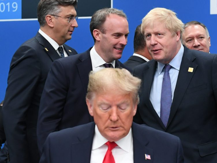 US President Donald Trump (front) with Foreign Secretary Dominic Raab (centre left) and Prime Minister Boris Johnson (centre right) during the annual Nato heads of government summit at The Grove hotel in Watford, Hertfordshire (Stefan Rousseau/PA)