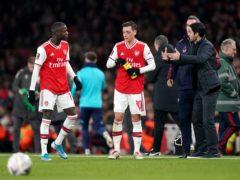 Nicolas Pepe (left) was sent off against Leeds, leaving Arsenal manager Mikel Arteta (right) unimpressed (John Walton/PA)