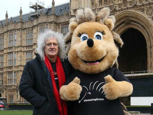 Brian May stands beside Grace the Hedgehog, mascot of the Save Me Trust (Jonathan Brady/PA)