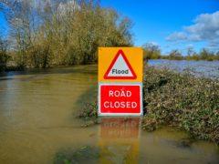 A flood warning sign (Ben Birchall/PA)