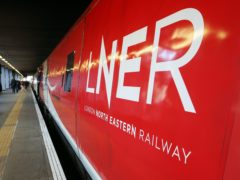 People planning Christmas train travel are being urged to book 'as early as possible' (Jonathan Brady/PA)