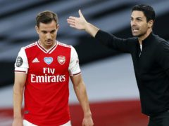 Arsenal manager Mikel Arteta (right) speaks to Rob Holding and Cedric Soares during the Premier League match at the Emirates Stadium, London.