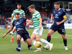Celtic will start the defence of their trophy against Ross County (Jeff Holmes/PA)