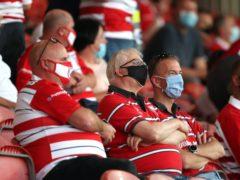 Gloucester fans wear masks at the Gallagher Premiership match against Harlequins at Kingsholm (David Davies/PA)