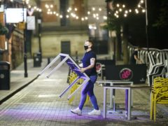 The services sector slowed its growth in October as Covid-19 restrictions hit pubs, restaurants and travel (Danny Lawson/PA)