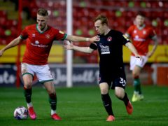 Walsall's Cameron Norman (left) and Leyton Orient's Danny Johnson battle for the ball during the Sky Bet League Two match at Banks's Stadium, Walsall.