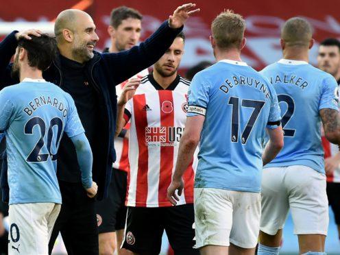 Pep Guardiola congratulates Bernardo Silva and Kevin De Bruyne after Manchester City's 1-0 win over Sheffield United at Bramall Lane (Rui Vieira/PA Images).