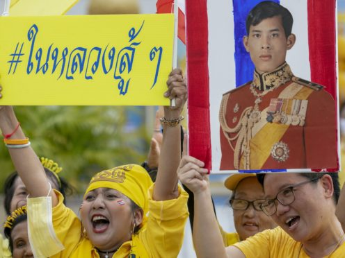 Supporters of the monarchy display images of King Maha Vajiralongkorn as they gather in front of the Grand Place in Bangkok, Thailand, Sunday (Wason Wanichakom/AP)