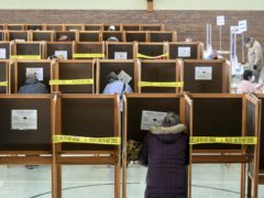 Voters cast their ballots at the St. Elizabeth of Hungary Parish Center in North Adams, Mass. on Tuesday, Nov. 3, 2020. (Gillian Jones/The Berkshire Eagle/AP)