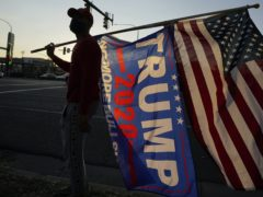 Trump supporters gather near in Salt Lake City, Utah on Tuesday. The Trump campaign's hopes that a wave of voters would emerge in smaller regional areas for Tuesday's election largely came to fruition (Rick Bowmer/AP)