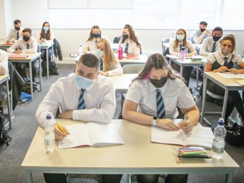 Schools will remain open for the three weeks restrictions are in place (Jane Barlow/PA)