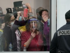Election challengers yell as they look through the windows of the central counting board (Carlos Osorio/AP)