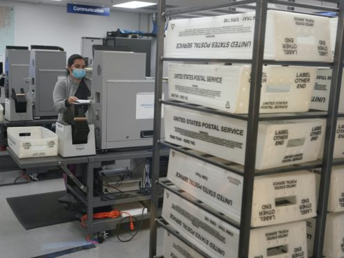 A worker scans ballots at the Miami-Dade County Elections Department in Doral, Florida (Wilfredo Lee/AP)