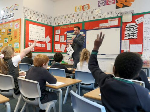 Pupils at Manor Park School and Nursery in Knutsford, Cheshire, take part in a phonics lesson, at the start of a four week national lockdown for England (PA)