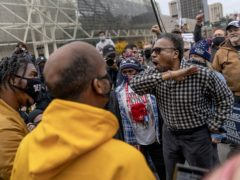 A Trump supporter argues with counter protesters while Trump supporters demonstrate against the election results outside the central counting board in Detroit on Thursday (David Goldman/AP)