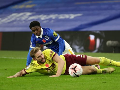 Tariq Lamptey challenges Charlie Taylor at the AMEX Stadium (Catherine Ivill/PA)