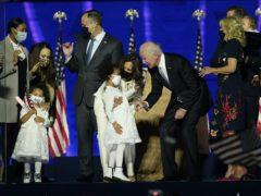 Vice President-elect Kamala Harris and President-elect Joe Biden stand on stage (Andrew Harnik/AP)