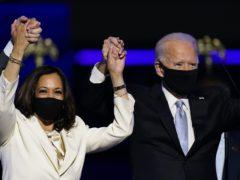 Vice President-elect Kamala Harris holds hands with President-elect Joe Biden (Andrew Harnik/AP)