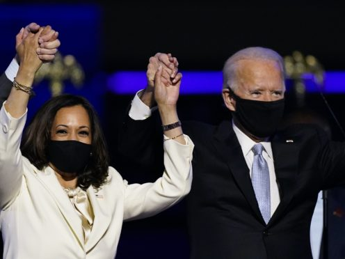 Vice President-elect Kamala Harris holds hands with President-elect Joe Biden (Andrew Harnik/AP)