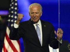 President-elect Joe Biden gestures to supporters in Wilmington, Delaware (Andrew Harnik/AP)