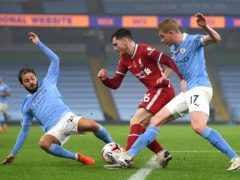Andrew Robertson (centre) battles for the ball against Manchester City (Shaun Botterill/PA)