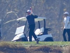 President Donald Trump plays golf at Trump National, Virginia, on Sunday, while maintaining his silence over his next moves (Steve Helber/AP)